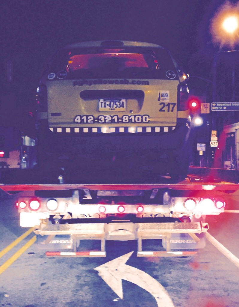 My favorite photo -- a dead Pittsburgh Yellow Cab being hauled away on a flat bed, taken while I was Ubering.